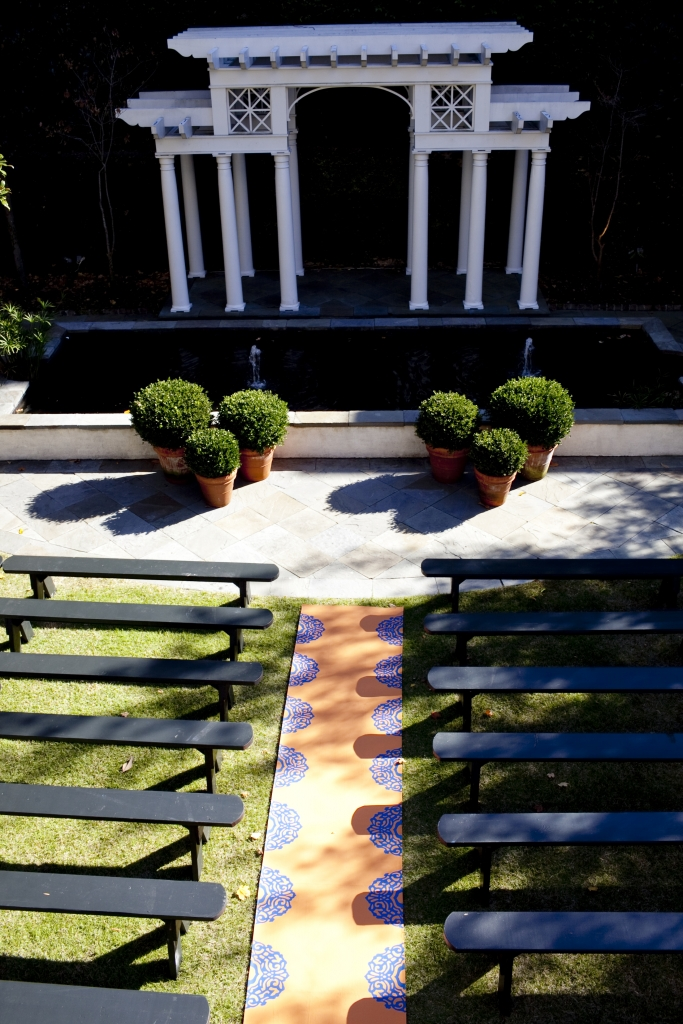 SET DESIGN: The ceremony was held in the backyard of the William Aiken House. Jessica and Ben's 150 guests watched them exchange vows from benches arranged on either side of the custom-made aisle runner.