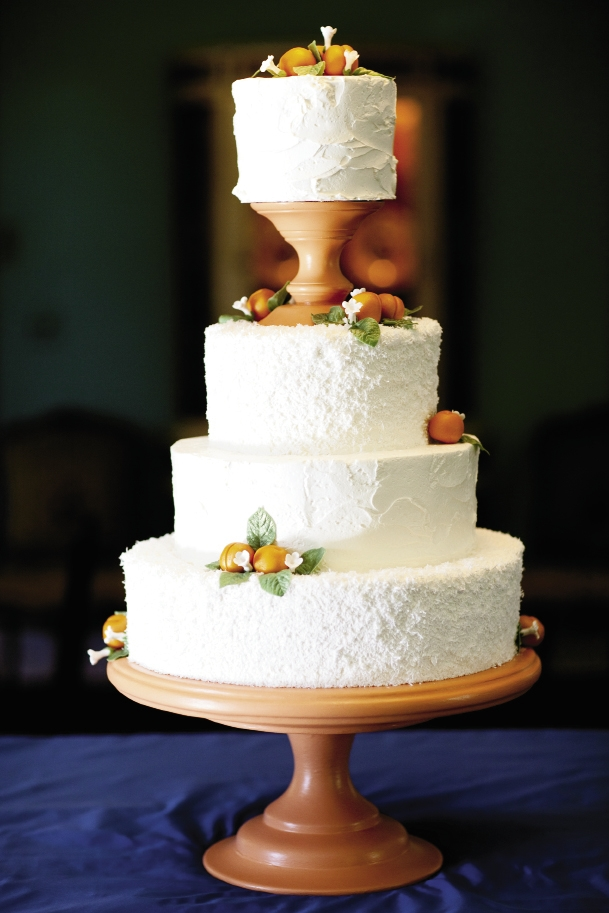 SUGAR HIGH: Wedding Cakes by Jim Smeal frosted the cake with two different icings—stuccoed buttercream and natural white coconut—then garnished the treat with marzipan apricots.
