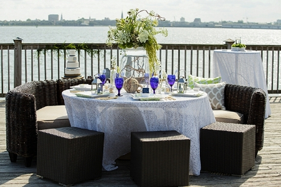 Rentals through Snyder Events. Flowers by On a Limb Floral Design. Cake by Delicious Desserts. Linens by Ultrapom. Shoot design by Scarlet Plan & Design. Image by The Click Chick Photography at Charleston Harbor Resort & Marina.