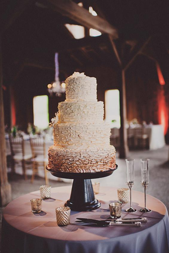 TASTE QUARTET: The cake, from Wedding Cakes by Jim Smeal, featured four flavors: red velvet, pistachio, blueberry buttercream, and pecan praline.