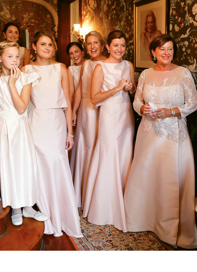 "Kathleen's sister, Mariana ""Mini"" Hay (second from right), mother, Mariana Hay, and the bridal party gathered in the foyer.   <i>Photograph by Charlotte Elizabeth</i>"