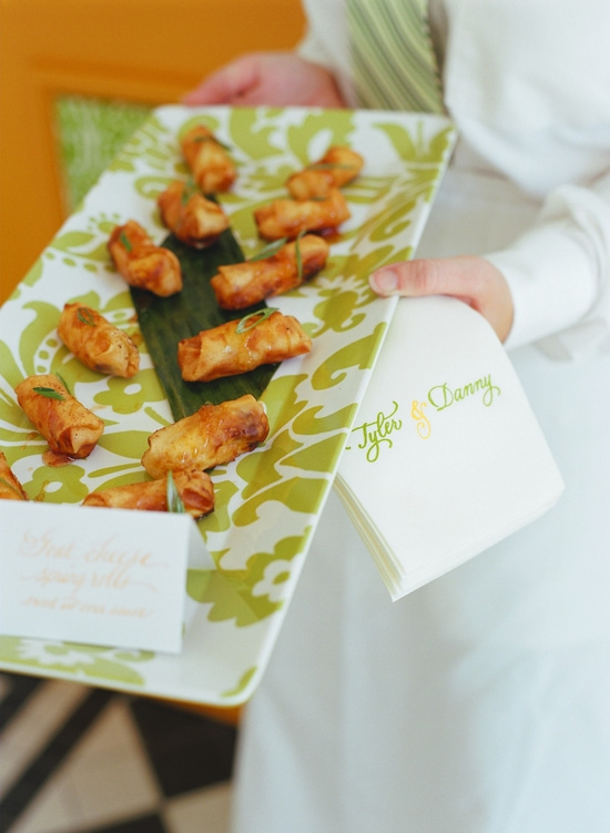 PATTERN PERFECT: Serving trays bore the same lime green and white floral pattern as the aisle runner, ring bearer pillows, and other small details of the décor.