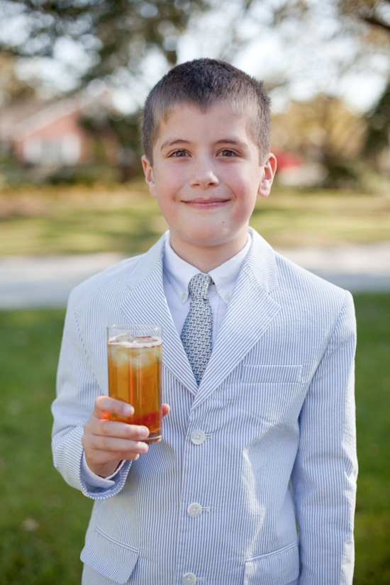 LOWCOUNTRY LAD: Complete with a seersucker suit and glass of sweet tea, a young guest shows off his Charleston charm.
