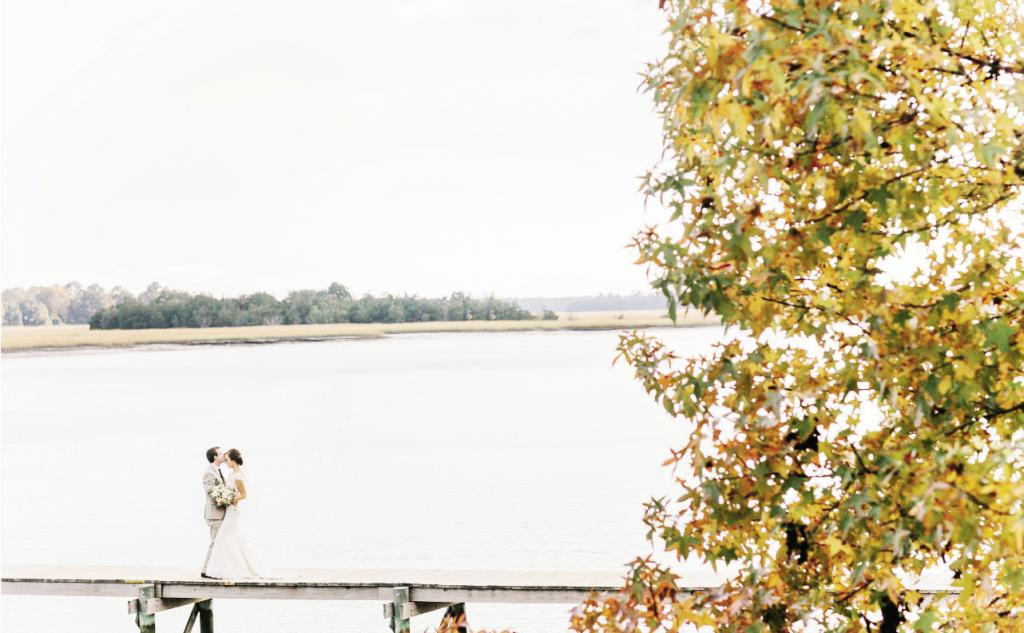 Located about half an hour south of Charleston in Hollywood, South Carolina, Old Wide Awake Plantation sits nestled on the Stono River. Jennifer and Bradley met on its private dock  for their pre-ceremony first look and portrait.