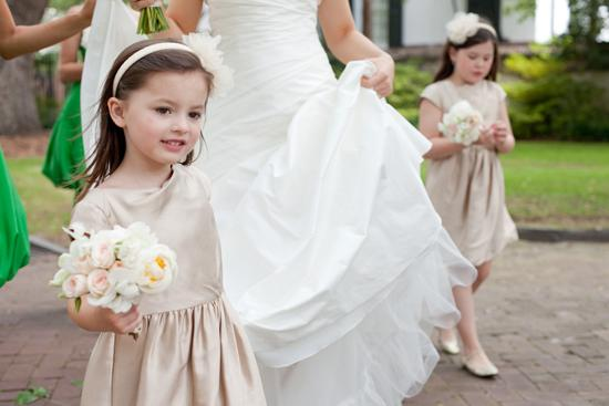 WALK THIS WAY: The flower girls, in champagne-hued frocks and headbands from J.Crew, were armed with mini versions of Jessica's bouquet by Heather Barrie of Gathering Floral + Event Design.