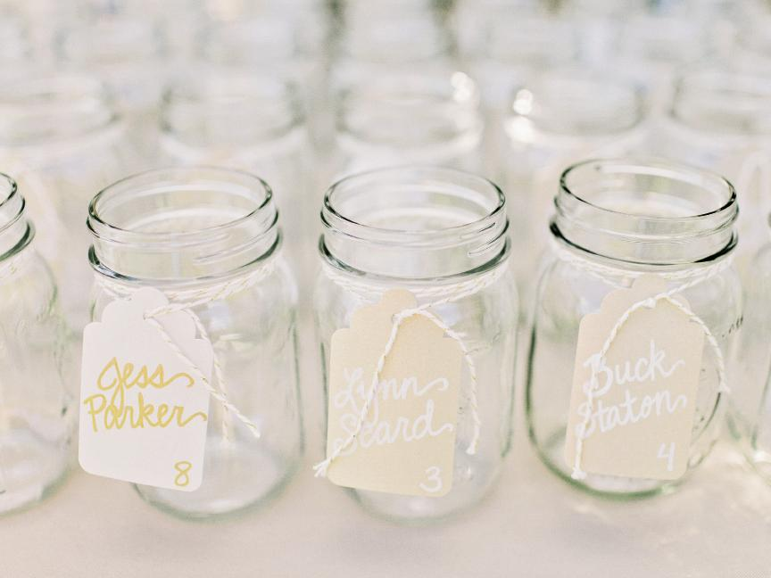 Jennifer used gold baker's twine to tie butler cards to Mason jars that  doubled as the guests' drinking vessels.