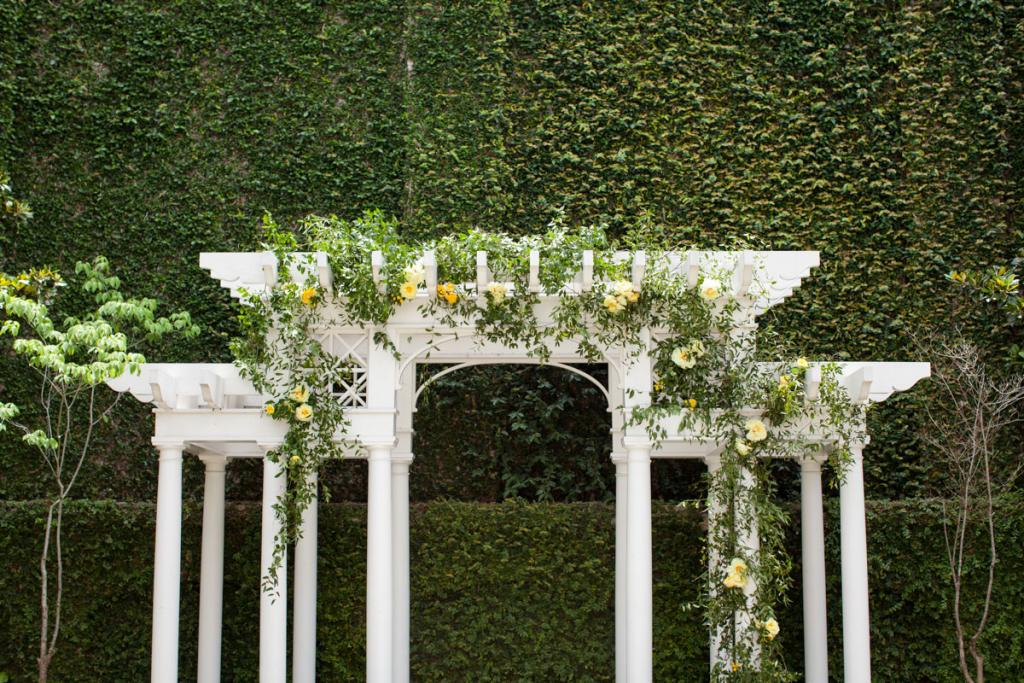 SMALL TOUCH: The William Aiken House and its grounds don't need much decoration, so Gathering Events added simple yellow vines to the arbor for the ceremony.
