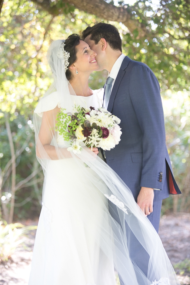 Bride's gown by Delphine Manivet. Menswear by SuitSupply. Florals by Charleston Stems. Photograph by Captured by Kate.