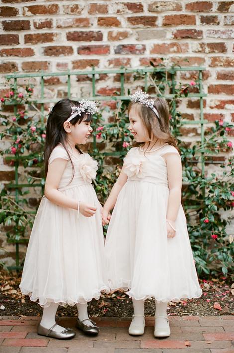 BOSOM BUDDIES: The flowergirls wore sweet frocks from Pretty Flower Girl.