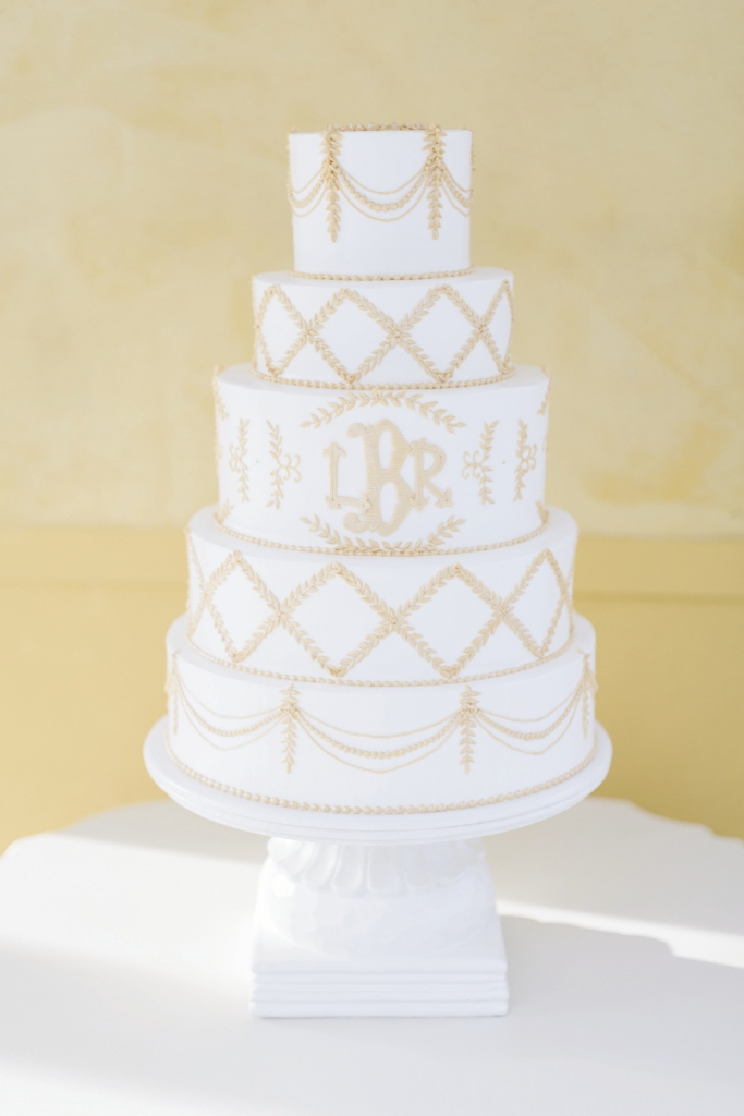 Wedding Cakes by Jim Smeal pulled inspiration from the garlands and monogram to fashion an immaculate butter cream covered cake.  Cake by Patrick Properties Hospitality Group. Image by Elisabeth Millay Photography.