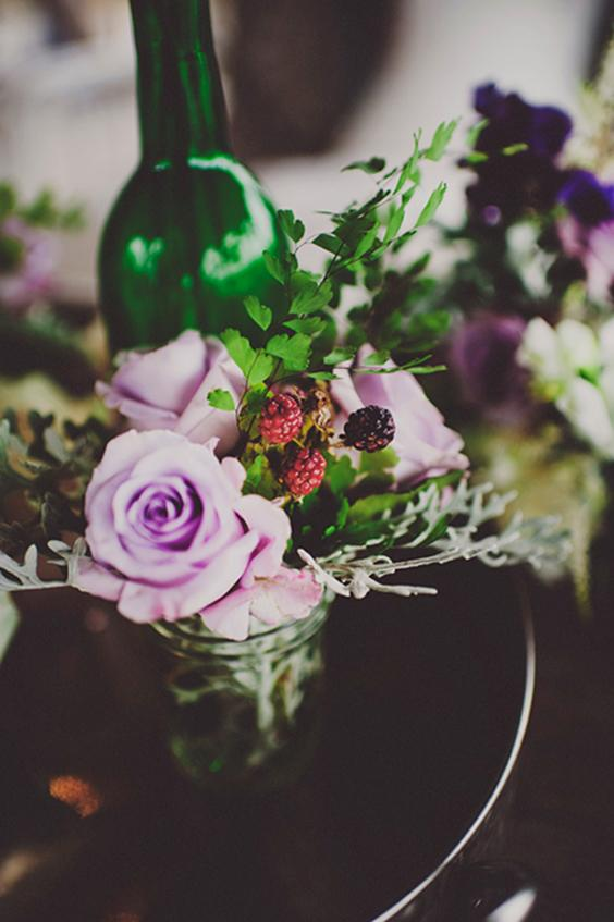 PURPLE POW: Mason jars held garden roses, Dusty Miller, and raspberries for an earthy, romantic effect.
