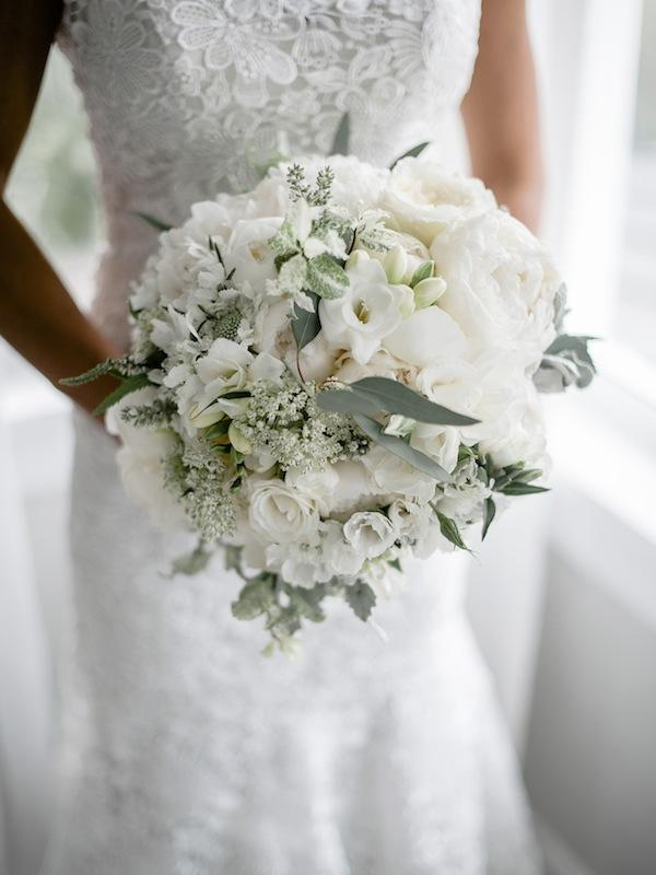 Bride's gown by Jenny Packham. Bouquet by Out of the Garden. Image by Brandon Lata Photography.