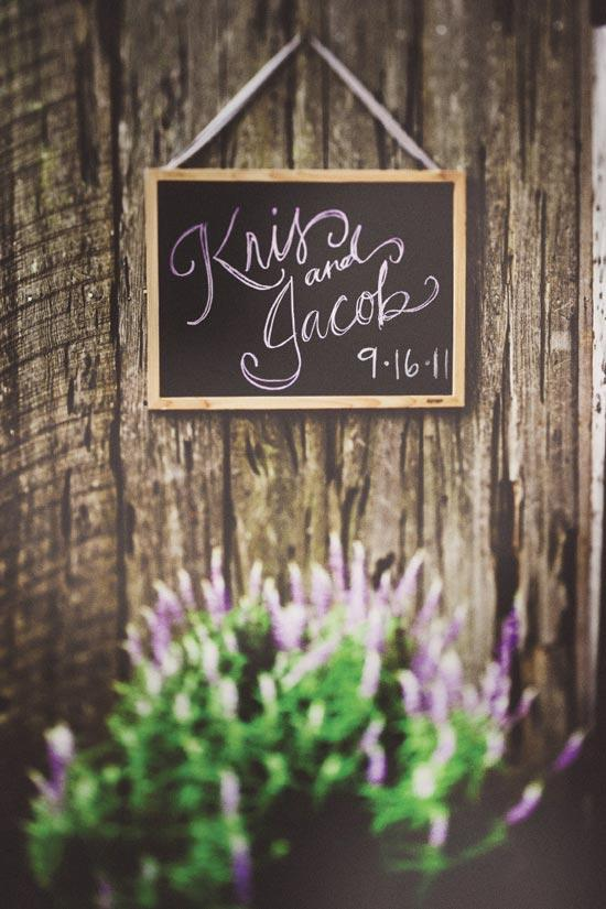 SIGN OF THE TIMES: The chalk for the handmade reception sign showcased the lilac and plum palette.