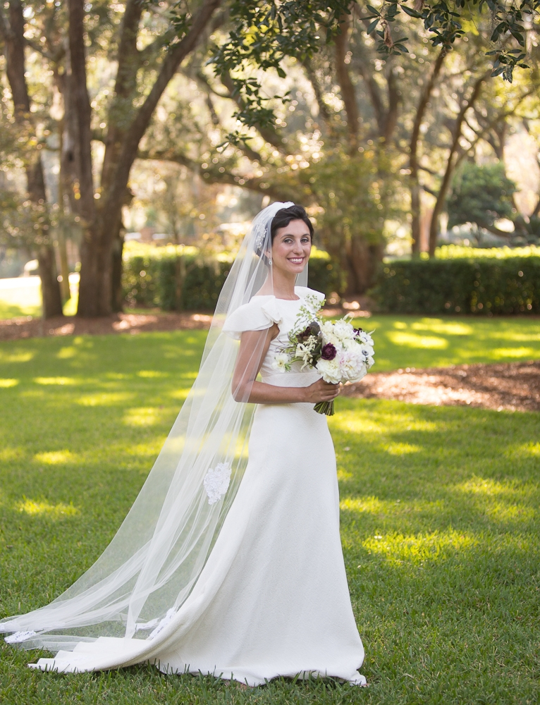 Bride's gown by Delphine Manivet. Florals by Charleston Stems. Photograph by Captured by Kate.