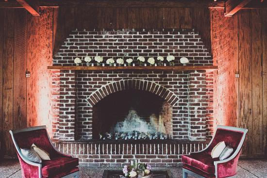 HOME IS WHERE THE HEARTH IS: Votive candles filled the fireplace and, alternating with hydrangea-filled vases, dressed the mantle, as well.