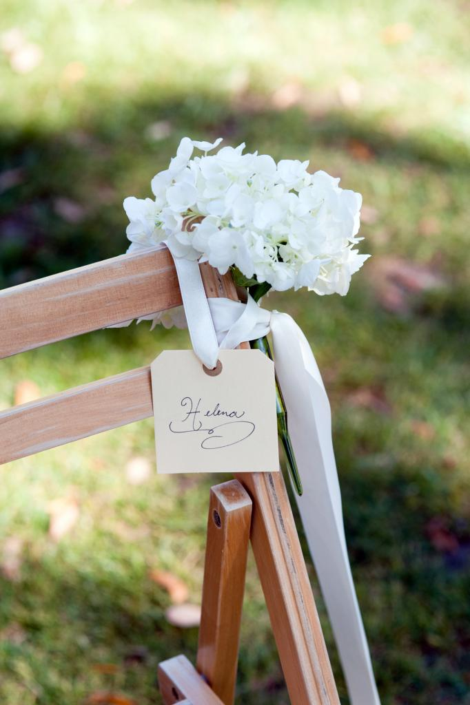 SAVE MY SEAT: Event designer Luke Wilson used silk ribbon to secure hydrangea bunches and nametags to ceremony chairs.