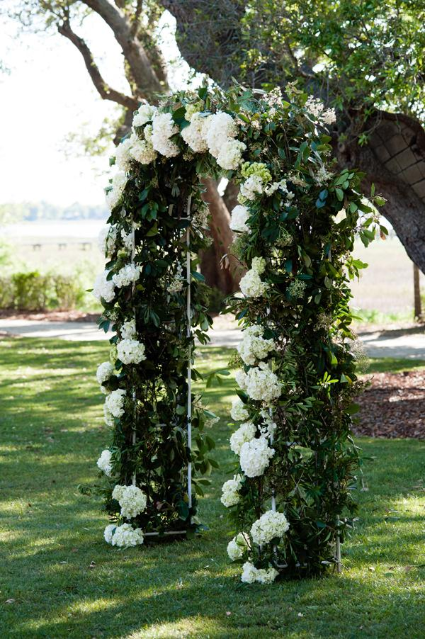 GREEN GARDEN: The couple exchanged vows beneath a trellis dressed in hydrangea and fresh vines.