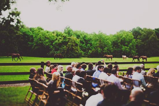 PASTORAL SETTING: Framed by the colorful green pastures of Boone Hall and some horses trotting by, the outdoor ceremony was one with nature.