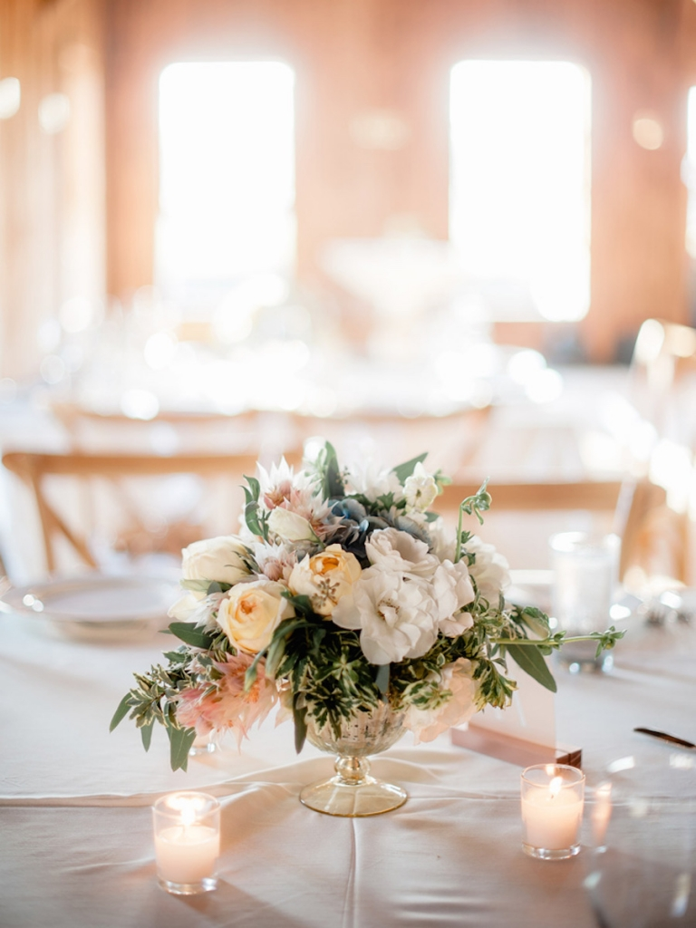 Wedding design by Ooh! Events. Florals by Out of the Garden. Linens from Connie Duglin Specialty Linens. Image by Brandon Lata Photography.