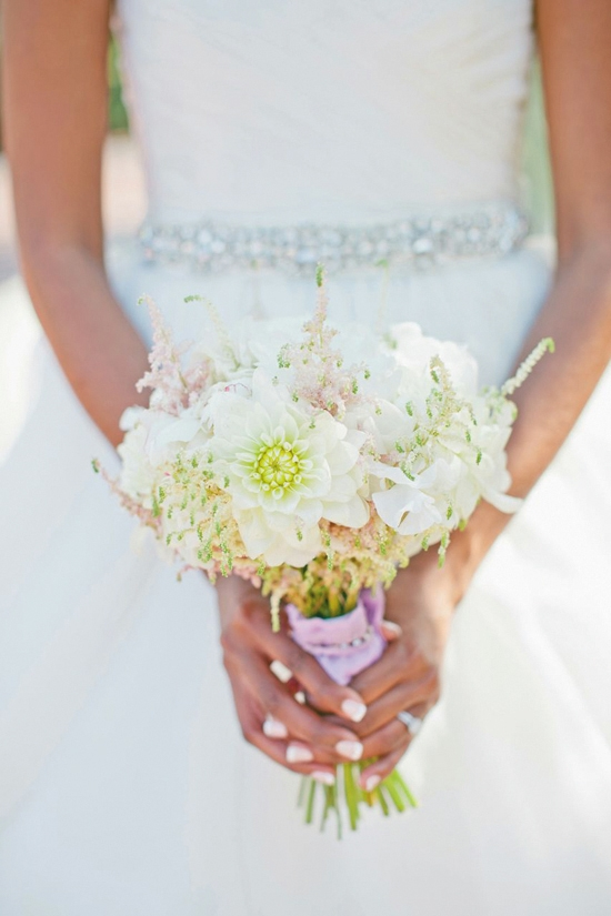 PERFECT PICK: The bride carried a bouquet of white peonies, pink and white astilbe, while dahlias, and sweet pea from Tiger Lily Florist.