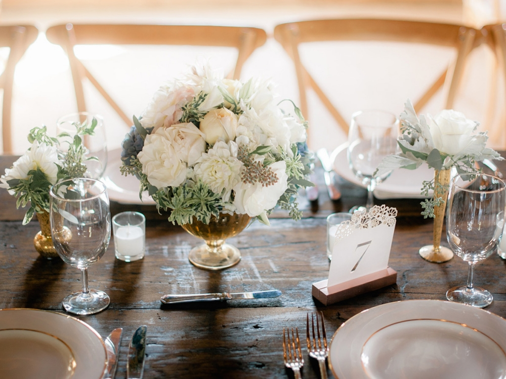 Wedding design and rentals by Ooh! Events. Table numbers from BHLDN. Florals by Out of the Garden. Image by Brandon Lata Photography.