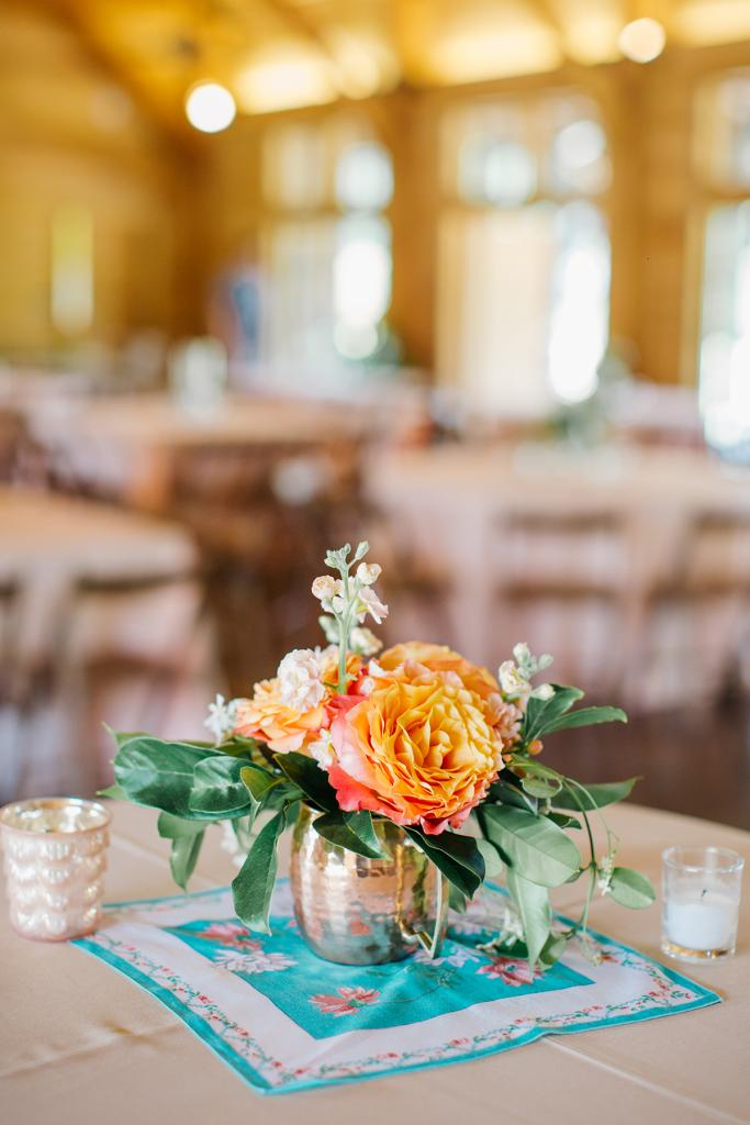 Work with Whatcha Got: A friend arranged blooms from Whole Foods and greens from her yard in flea-market vases that sat atop heirloom hankies from the bride's family.