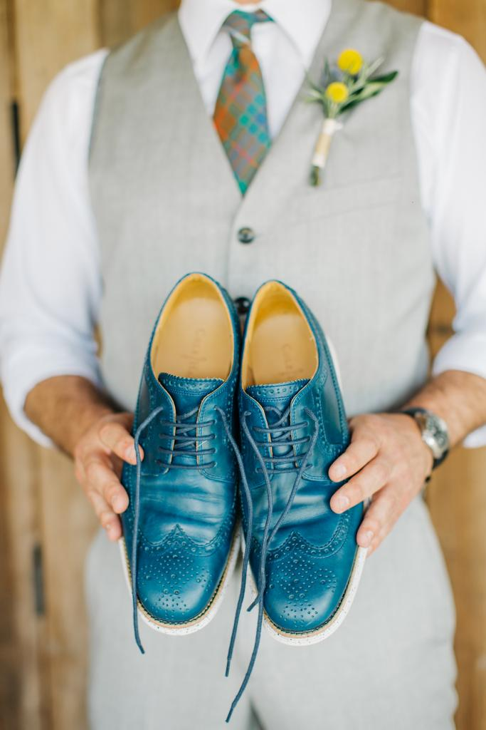 Be Colorful: The groom's blue leather brogues coordinated with his tie, which was made in his family's tartan.