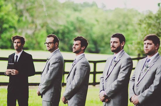 SUPPORTING CAST: The groomsmen awaited Kristin's arrival down the aisle in charcoal-colored J.Crew tuxes.