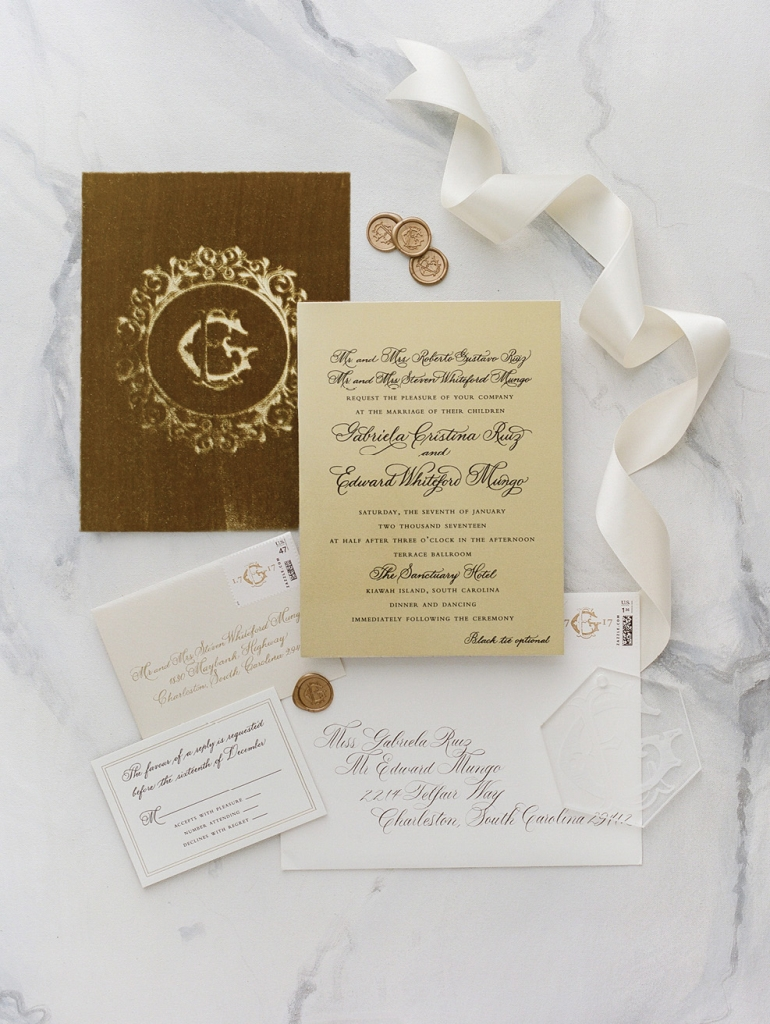 Embossed with the couple's ornate crest, Lettered Olive's stationery suite set the gilded tone for a night to be remembered.  <i>Photograph by Corbin Gurkin</i>
