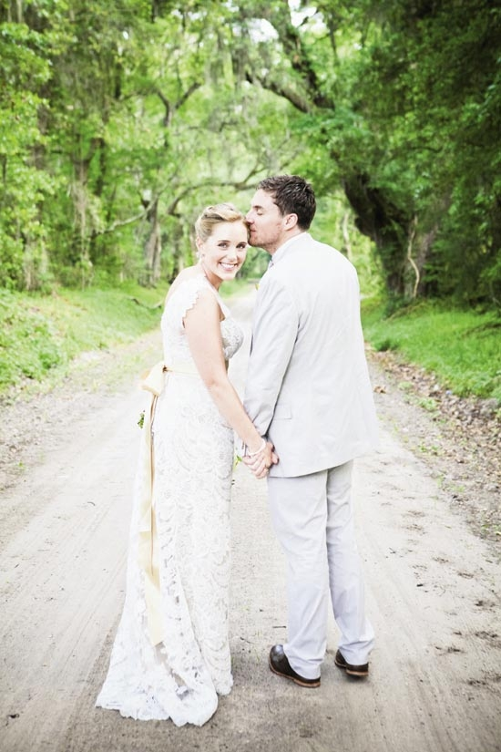 HAPPY DESTINY: The couple, who wed on a sea island rife with dirt roads, wore Ulla-Maija from Maddison Row (her) and J.Crew (him).