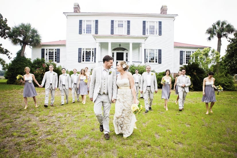 """SHADES OF GRAY: """"I was somewhat obsessed with  incorporating gray,"""" says Carrie of the groomsmen's J.Crew suits and the bridesmaids' Melissa Sweet dresses from Bella Bridesmaid. Yellow bouquets and boutonnieres tied the looks to the rest of the wedding's colors."""