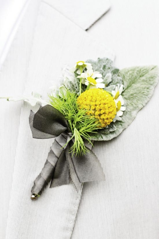 MARK OF A GENTLEMAN: Out of Hand made boutonnieres of Billy Balls, daisies, and greens.