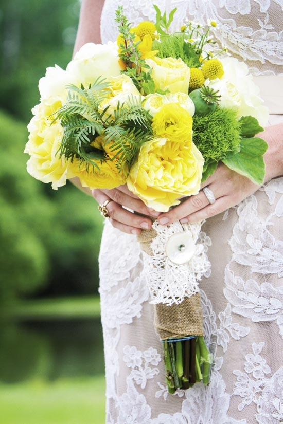 QUITE A HANDFUL: For the countryside wedding (with a Southern accent), Out of Hand married unpretentious blooms like chamomile, peonies, runuculus, roses, and Billy Balls with greens like geranium leaves and ferns. To finish, they wrapped the bundle in burlap and cotton lace, and pinned it with a mother-of-pearl button.