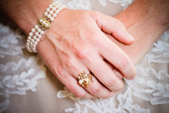 """THE PERFECT TOUCH: Jewelry from her stepmother's side of the family fit the bill for the bride's """"something borrowed."""" Carrie says she loved how the pieces fit in with the evening's vintage vibe."""