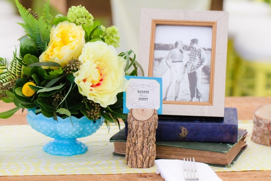 "RUSTIC CHIC: Wooden accents and antique books gave the tables a vintage vibe. ""We're fans of eclectic, vintage, one-of-a-kind finds,"" says Carrie."