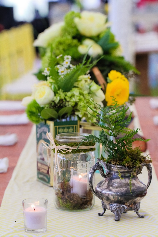 INDOOR-OUTDOOR: Out of Hand married natural touches like moss and straw met with tarnished silver and Mason jar vessels.