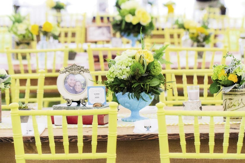 SNAPSHOT: Each table featured a portrait of the couple.