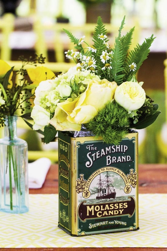 JUMP BACK: Ooh! Events filled vintage vessels with chamomile, dill, fern fronds, green hydrangea, and yellow roses.