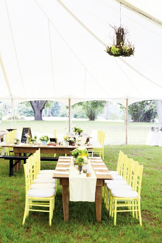 COLORFUL STORY: Carrie spotted her dream palette of yellow, gray, and blue in a wedding magazine, so Jonny contacted the featured couple to get their Pantone colors. The rented chairs were custom-painted to suit her vision.