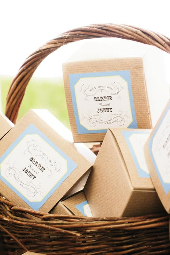"""I'LL TAKE IT TO GO: """"We ordered small brown to-go boxes and customized them with 'Carrie Married Jonny' stickers. People could take home a slice of our tasty wedding cake or cupcakes,"""" says Carrie of the dessert spread."""