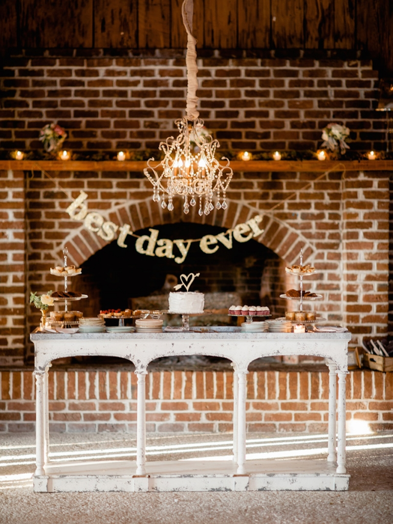Signage and cake topper from BHLDN. Wedding design and rentals by Ooh! Events. Sweets by WildFlour Pastry. Image by Brandon Lata Photography at Boone Hall Plantation and Cotton Dock.