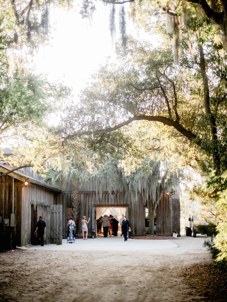 Wedding design by Ooh! Events. Image by Brandon Lata Photography at Boone Hall Plantation and Cotton Dock.