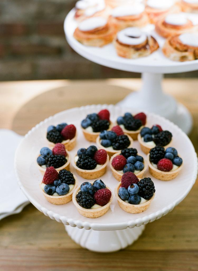 TAKE YOUR PICK: Liz's teatime theme called for treats—like these mini custard and fruit tarts and cinnamon rolls—befitting of the time of day.