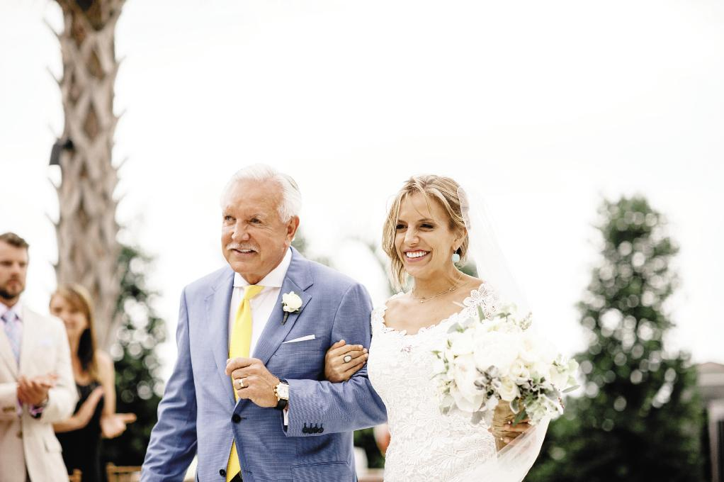 FATHER KNOWS BEST: Proud father  Tommy Baker escorted Katie down the aisle.  He and Jason donned suits in varying shades of blue; the groomsmen went casual with dark-wash jeans and vests.
