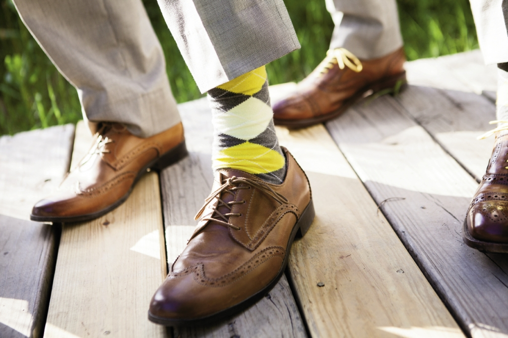 MELLOW YELLOW: Michael and his groomsmen wore argyle socks in the day's palette of lemon yellow and gray.