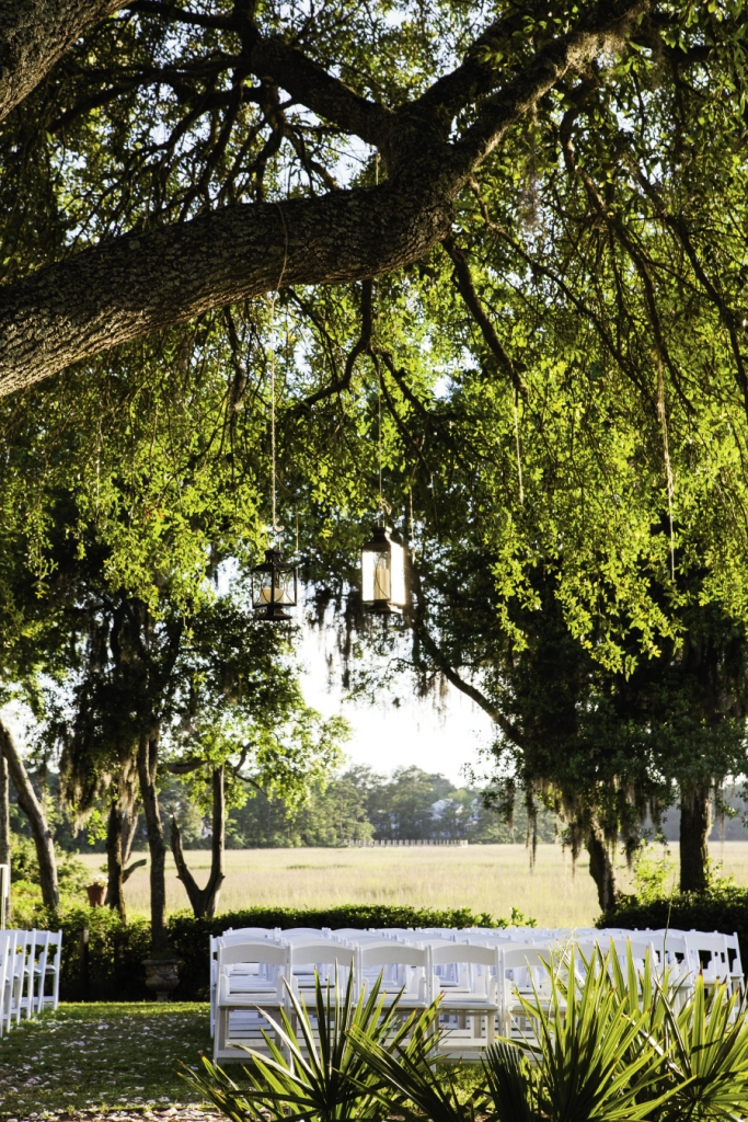 PLAIN PRETTY: The stunning setting suited pared-back decorations, like these simple hanging lanterns.