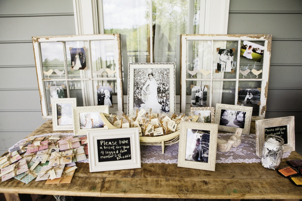 A FAMILY AFFAIR: The couple displayed their parents' and grandparents' wedding photos on two rustic window frames on the favor table.  Alongside their CD favors were gift bags with doggie treats to honor their pup, Maddie, who had to miss the festivities.