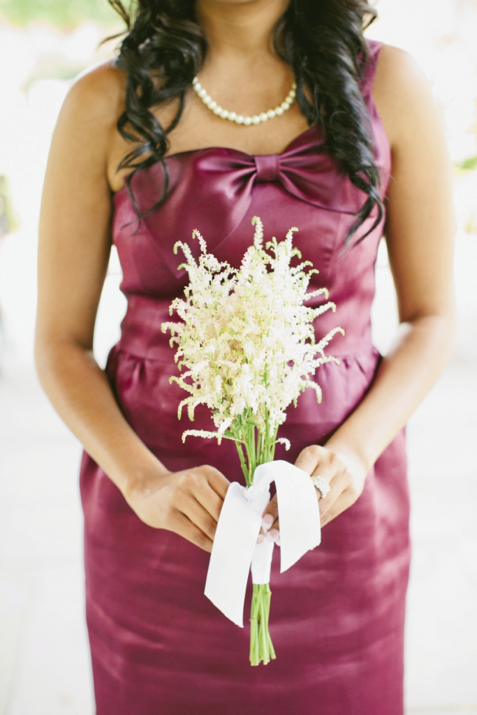 SOFT SIMPLICITY: Tiger Lily arranged simple, summery bouquets of white astilbe to soften the vibrant spiced wine color of the bridesmaids' J.Crew dresses.