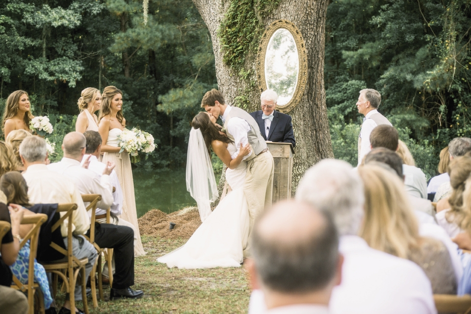Ooh! Events hung an antique mirror on the altar space's towering oak to afford guests a peek at the couple's expressions during the ceremony.