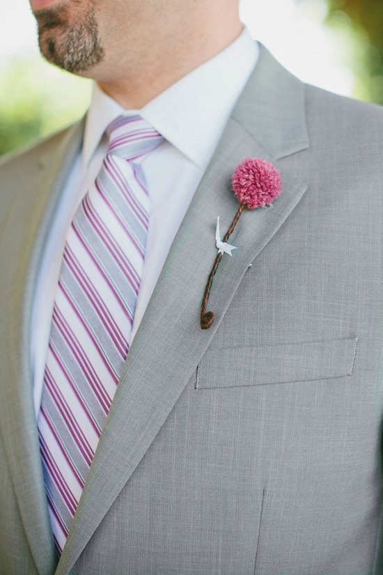 "DELICATE DETAIL: Groomsmen wore small berry colored yarn pom pom boutonnieres made by Heather Carr with ""stems"" of floral tape tied with a tiny bit of ribbon."